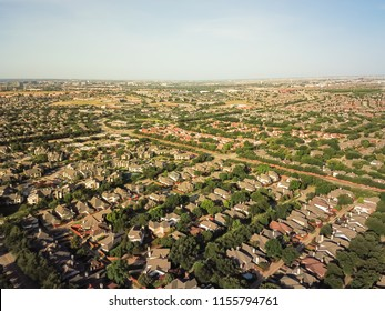 Aerial view urban sprawl near downtown Dallas, Texas, USA. Suburban tightly packed homes neighborhood with driveways, apartment building complex flyover. Vast suburbia subdivision in Irving, Texas, US