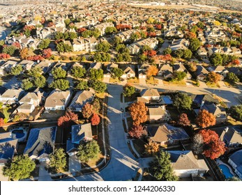 Aerial view Valley Ranch planned unit development in suburbs Dallas, Texas. Flyover sprawl subdivision in fall season with colorful foliage laves and row of single-family houses community