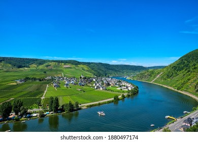 """Aerial view of the valley of the river Moselle (Mosel, Germany) near the famous village and tourism hotspot """"Beilstein"""" with ferry, village, vineyards and campsite"""