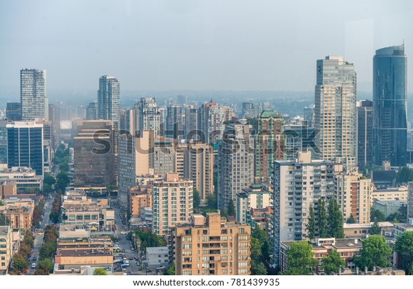Aerial view of Vancouver Downtown skyline from city rooftop, British Columbia, Canada.