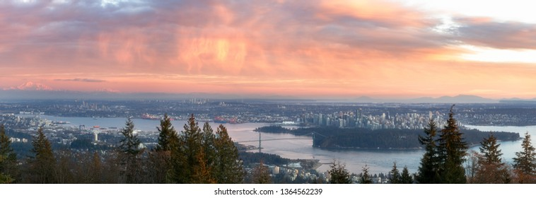aerial view of vancouver skyline at sunset.