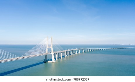 Aerial View Of Vasco da Gama Bridge And High Car Traffic In Lisbon City Of Portugal