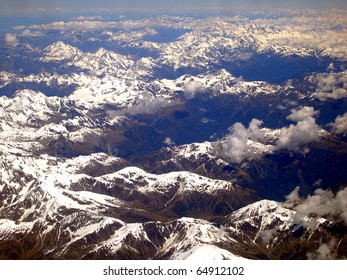 Aerial View of a vast Mountain Range flying east over the South Island and into Christchurch, New Zealand.