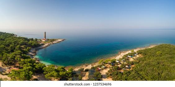 Aerial view of Veli Rat camp and lighthouse on island Dugi Otok in Croatia.