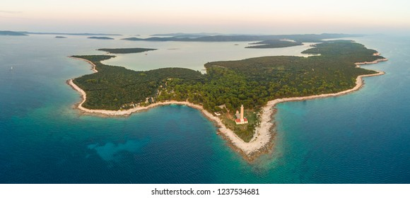 Aerial view of Veli Rat lighthouse and bay on island Dugi Otok in Croatia.
