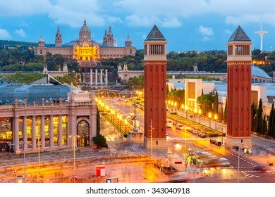 Aerial view of venetian columns, National Art Museum and Placa Espanya in Barcelona at night, Catalonia, Spain