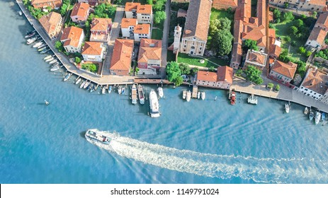 Aerial view of Venetian lagoon and cityscape of Venice island in sea from above, Italy