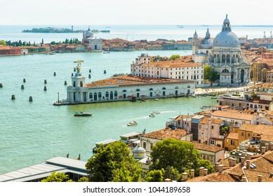 Aerial view of Venice in summer, Italy. Basilica di Santa Maria della Salute, Grand Canal and sea. Venice in the sunlight. Cityscape and landscape of Venice. Panorama and skyline of sunny Venice.