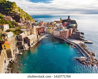 Aerial view of Vernazza, one of the five centuries-old villages of Cinque Terre, located on rugged northwest coast of Italian Riviera, Liguria, Italy.