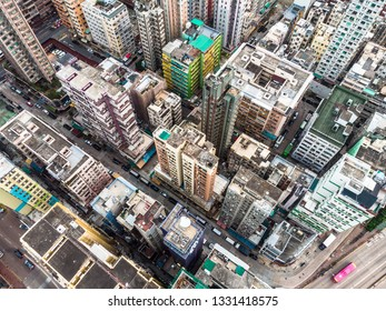 Aerial view of a very densely populated district in Kowloon city in Hong Kong. Hong Kong is famous for having a very high density population.