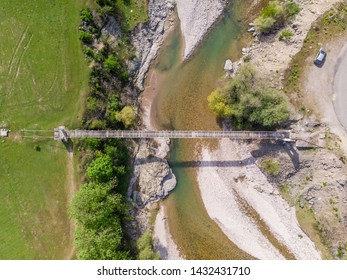 Aerial view of very old and rusty suspension bridge over Borovitsa river in the Rhodope mountain in Bulgaria
