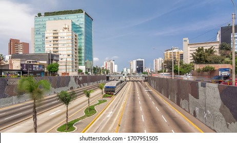 Aerial view of Via Expresa highway and metropolitan bus with traffic timelapse hyperlapse and blue sky with clouds. Skyscrapers on a background. Lima, Peru