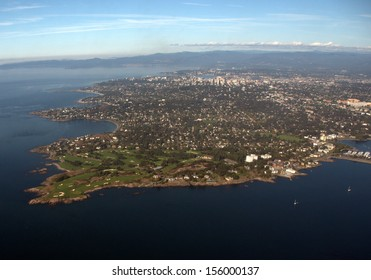 Aerial view Victoria, British Columbia, Canada from east.  The wealthy Oak Bay community is in the foreground, the city in the center top and the University of Victoria on the right.