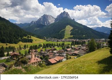 Aerial view of Vigo di Fassa mountain village in Val di Fassa, Trentino, Italy