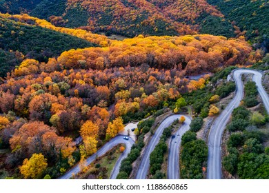 Aerial view of the the Vikos Gorge in the autumn and provincial road with many zigzag in the Epirus Zagorohoria, Greece. National park