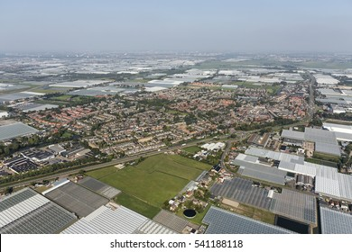 Aerial view of village De Lier, surrounded by greenhouses in Westland, an area with thousands of glass houses near The Hague, in the province of Zuid-Holland, Netherlands.
