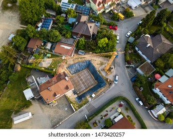 Aerial view of village in Germany with solar panels and a construction site. Looking straight down with a satellite image style, the houses look like a miniature village