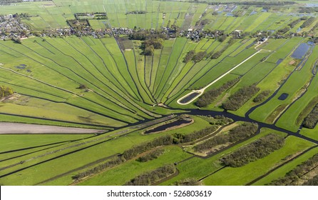 Aerial view of the village of Loosdrecht in a nature reserve area with a beautiful pattern of meadows and ditches in the province of Noord-Holland in the Netherlands.