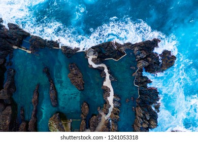 Aerial view of the village of Porto Moniz with lava-rock pool, Madeira Island, Portugal