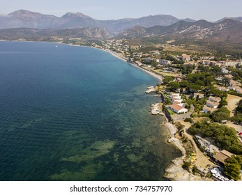 Aerial view of the village of Saint Florent, Corsica. Harbor boats and houses. France