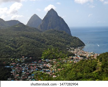 Aerial view of the village of Soufriere, St. Lucia and the iconic volcanic spires called Les Pitons