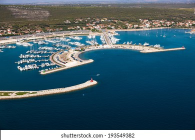 Aerial view of village Sukosan and marina Dalmacija, Croatia, Dalmatia county with islands in the background.