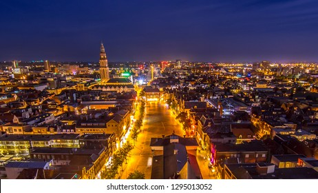 Aerial view of vismarkt square in historic town centre of Groningen city at night. The Netherlands.