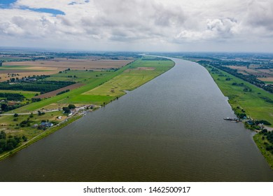Aerial view of the Vistula river mouth to the Baltic sea. Poland. Photo made by drone from above. Bird eye view.