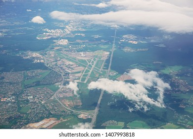 Aerial view of the Vnukovo airport. View from the airplane window. Flying in a airplane over the clouds