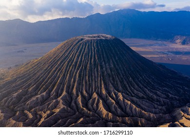 Aerial view of the volcanic cinder cone Mount Batok in the Mount Bromo national park, Java, Indonesia