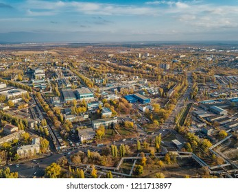 Aerial view Voronezh from height of aircraft flight. Voronezh synthetic rubber plant district in autumn.