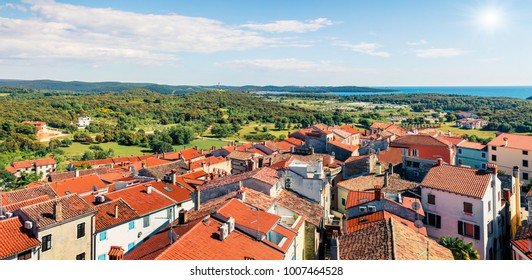 Aerial view of Vrsar (Orsera) town. Colorful spring cityscape of Croatia, Europe. Traveling concept background. Beautiful Mediterranean seascape.
