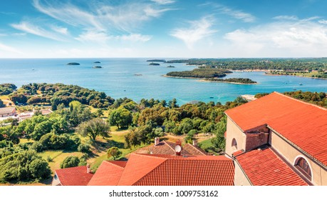 Aerial view of Vrsar (Orsera) town harbor. Sunny spring cityscape of Croatia, Europe. Traveling concept background. Beautiful Mediterranean seascape.