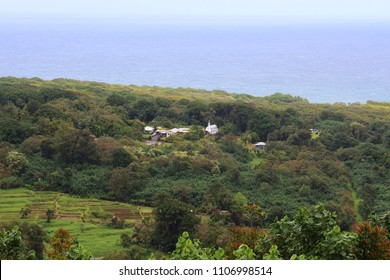An aerial view of Wailua Village from the Wailua Overlook, with a white coral church, homes, rain forest and taro patches in Kula, Maui, USA