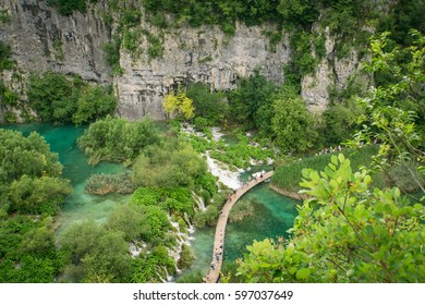 An aerial view of walkways, lakes and waterfalls in the beautiful Plitvice Lakes National Park, one of the oldest national parks in Eastern Europe.