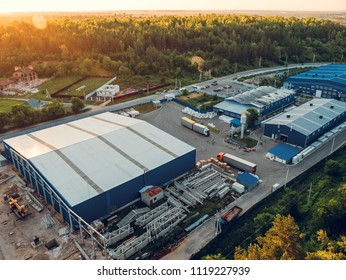 Aerial view of warehouse storages or industrial factory or logistics from above. Aerial view of industrial buildings and equipment machines, toned