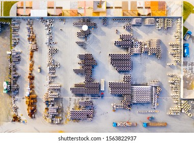 Aerial view of warehouse with truck and forklift stacker . Industrial background. Logistics from above. Industry in European Union.