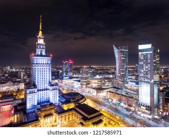 Aerial view of Warsaw downtown and The Palace of Culture and Science in Warsaw at night. Poland.