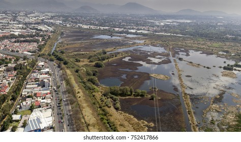 Aerial view of water regulation pond in the urban area of Mexico City