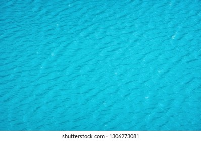 Aerial view at the water surface. Turquoise sea as a background. Waves on the sea. Waves as a background. Water-image