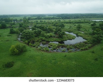 Aerial view of the water, swampy terrain and meadows