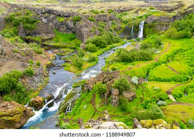 Aerial view of the waterfall and the stream in the Gjain Canyon in Highlands of Iceland