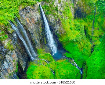 Aerial view to waterfall in tropical rainforest. The Trou de Fer - Iron Hole canyon in Cirque Salazie is amazing scenery in center Reunion Island, overseas department of France. Natural landmark.
