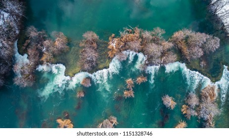 Aerial view of waterfalls on river Mreznica during snowy winter, Karlovac, Croatia