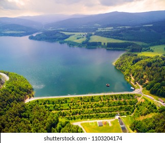 Aerial view to water-supply reservoir Nyrsko on Uhlava river in National Park Sumava with rainy clouds over. Source of drinking water for western Bohemia. Czech Republic, Central Europe.