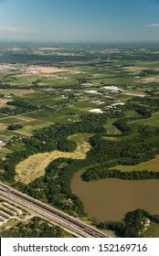 Aerial view of waterway, agriculture and highway