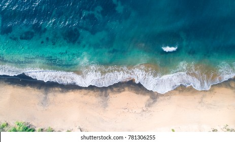 Aerial View of Waves and Beach on Early Morning