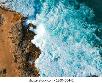 Aerial view of waves crashing against the coastline. Seascape panorama taking with a Drone.