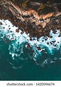 Aerial view of waves crashing on the rocks in Cascais on the coast of Portugal.