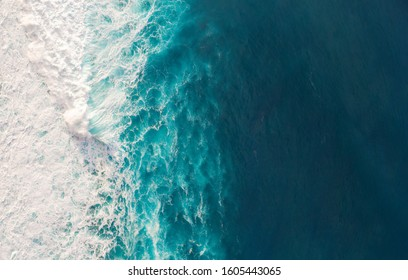 Aerial view to waves in ocean Splashing Waves. Blue clean wavy sea water.